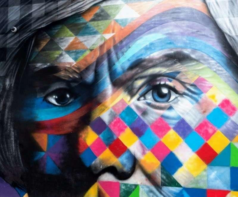 Andy Warhol's eyes in colorful street mural by Eduardo Kobra