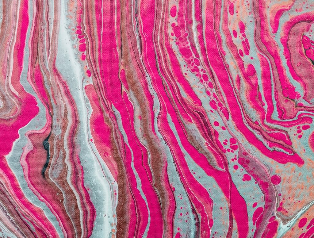 Scott Webb photo of abstract art. Shades of pink, red, gray and rust.